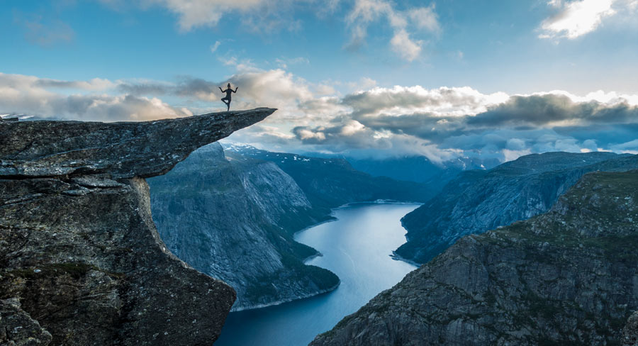 Woman in yoga-pose on Trolltunga